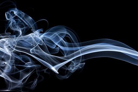 Closeup shots of smoke rising off incense. Banco de Imagens
