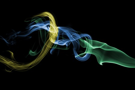 particulate: Abstract background of the details of smoke in false green, blue, and yellow colors.