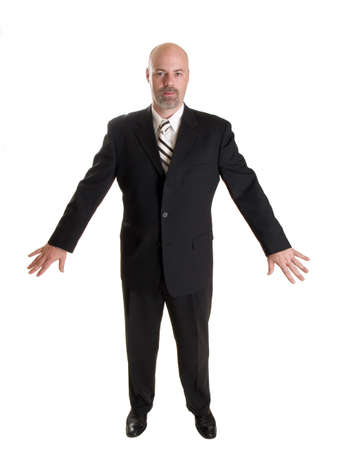 Stock photo of the front side of a well dressed businessman holding his arms out to his side in a gesture as if he were holding back a crowd.  Full length, isolated white.