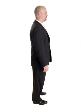 profile: Stock photo of the side view profile of a well dressed businessman.  Full length, isolated white.