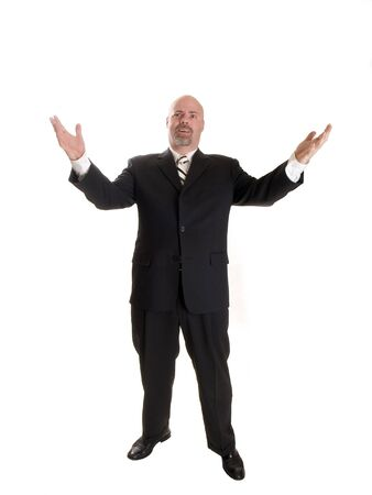 Stock photo of a well dressed businessman holding his arms up in a gesture, with a shocked expression on his face.  Full length, isolated white. photo