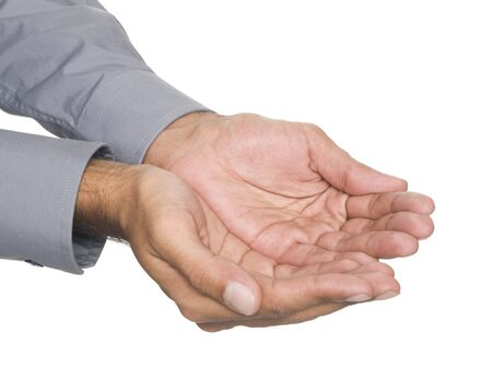 Isolated studio shot of a businessman's cupped hands. Stock Photo - 8047001
