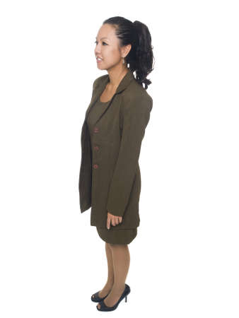 Isolated full length studio shot of a businesswoman facing away to her right. Stock Photo - 8081087