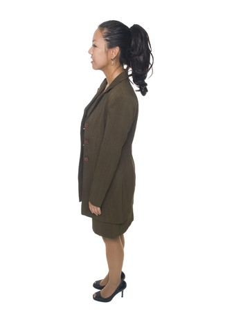 Isolated full length studio shot of a businesswoman facing sideways. Stock Photo - 8081035