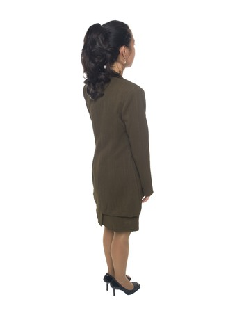 Isolated full length studio shot of a businesswoman looking away to her right.