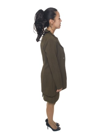 Isolated full length studio shot of a businesswoman facing sideways. Stock Photo - 8081011