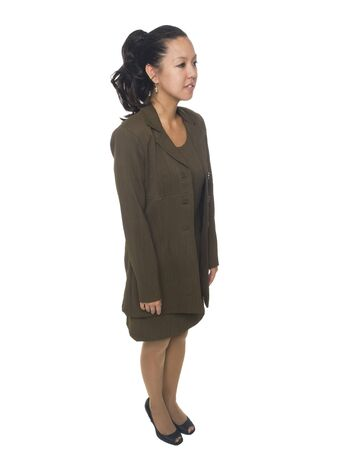 Isolated full length studio shot of a businesswoman facing away to her left. Stock Photo - 8081102