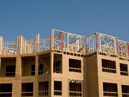 substructure: Urban construction site under a blue sky with white clouds.  Woodframe on a concrete substructure. Stock Photo