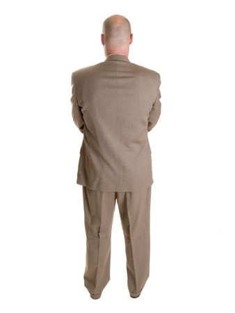 dorsal: Stock photo of the back side of a well dressed businessman facing away from the camera.  Full length, isolated white.