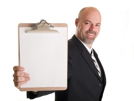 salaried: Stock photo of a well dressed businessman holding a clipboard.