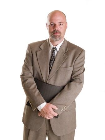 Stock photo of a well dressed businessman holding a notebook, isolated on white. Stock Photo - 8081143