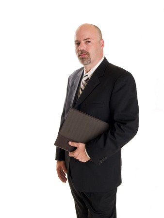 salaried: Stock photo of a well dressed businessman holding a notebook.