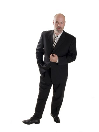 executive job search: Stock photo of a stylishly dressed man in a business suit, isolated on a white background. Stock Photo