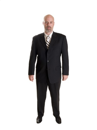 Stock photo of a well dressed confident businessman looking directly at the camera, full length, isolated on white. Stock Photo - 8080474