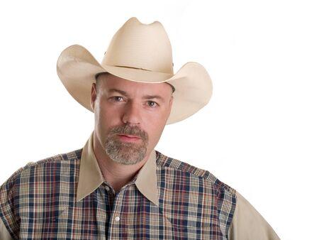 Foto di riserva di un cowboy isolato su bianco.