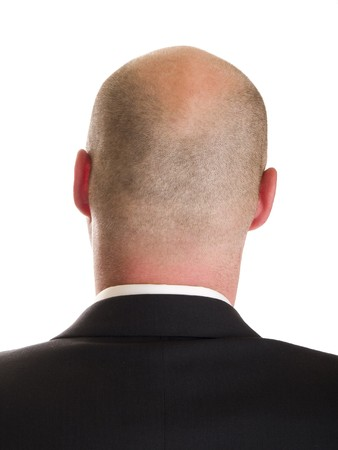 Stock photo of the back side of a businessmans head, isolated on white.