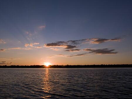 Stock photo of a sunset over the Mississippi River photo