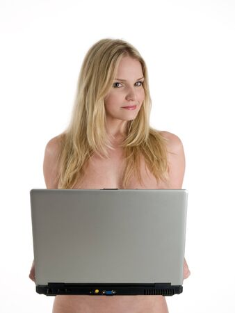 nude blonde woman: A nude blonde woman holding a laptop computer.
