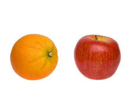 Isolated studio shot of a comparison of an apple to an orange on a white background. Stock Photo