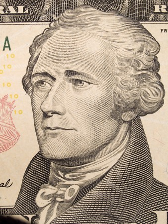alexander hamilton: Stock macro photo of a United States ten dollar bill, featuring Alexander Hamilton and the United States Treasury.
