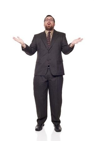 disbelief: Isolated full length studio shot of the front view of an upset businessman with open mouth, raising his arms in disbelief as if giving up.