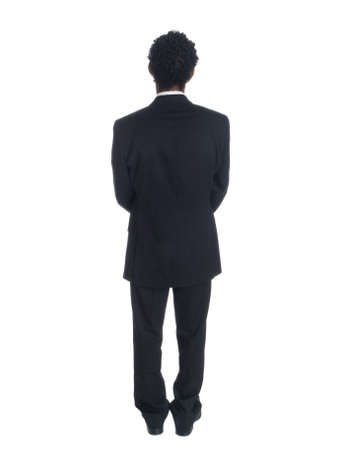 Isolated studio shot of a businessman from behind.
