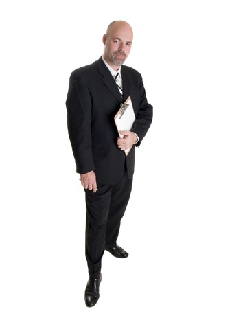 Stock photo of a well dressed businessman holding a clipboard. Stock Photo - 8080464