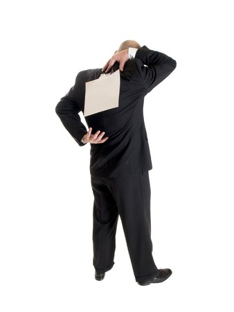 Stock photo of the back side of a well dressed businessman facing away from the camera with a blank sheet of paper taped to his back. Reklamní fotografie
