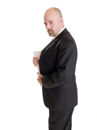 corporate espionage: Isolated stock photo of a caucasian businessman looking at the camera while showing the corner of a secret document he has hidden in his coat.