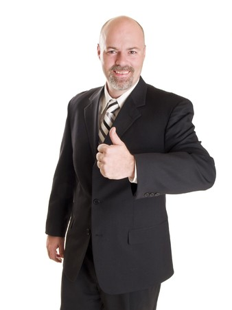Isolated stock photo of a caucasian businessman looking at the camera and smiling while giving a thumbs up. photo