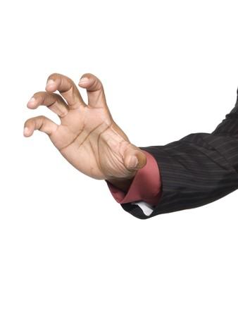 Isloated studio shot van een close-up beeld van een man te bereiken van het scherm te grijpen iets.
