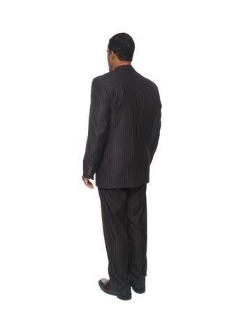 Isolated full length studio shot of a businessman from behind. photo
