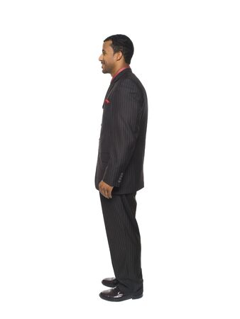 facing away: Isolated full length studio shot of a businessman facing to the left. Stock Photo