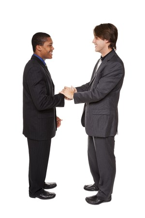 Isolated studio shot of two businessmen shaking hands in a warm, friendly greeting. Stock Photo - 8052494