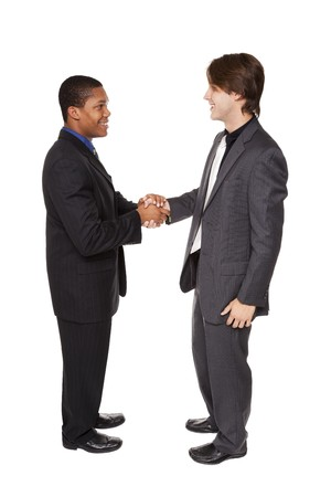 Isolated studio shot of two businessmen shaking hands in a warm, friendly greeting. Stock Photo - 8052504