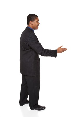 Isolated studio shot of a businessman reaching out to shake hands. Imagens