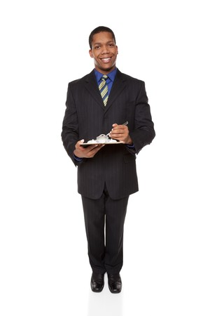 Isolated full length studio shot of a businessman filling out a questionnaire on a clipboard. photo