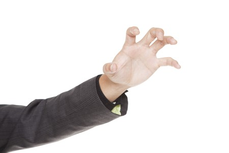 clawing: Isolated studio shot of a businessmans outstretched clawing hand. Stock Photo