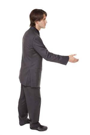 Isolated studio shot of a businessman reaching out to shake hands. Banco de Imagens