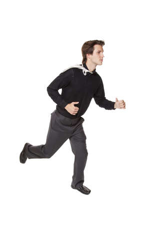Isolated studio shot of a businessman running photo