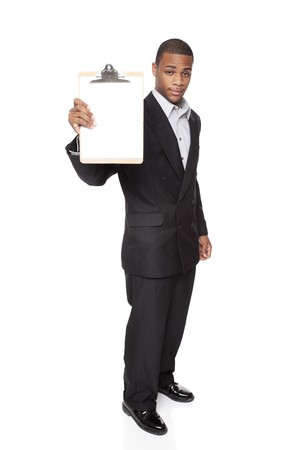 Isolated studio shot of an African American businessman presenting a blank clipboard to the camera. Stock Photo - 8081670