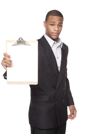 Isolated studio shot of an African American businessman presenting a blank clipboard to the camera. photo