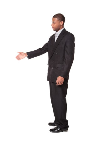 Isolated studio shot of an African American businessman reaching out to shake hands. Stock Photo - 8081823