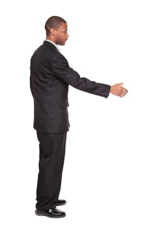 Isolated studio shot of an African American businessman reaching out to shake hands. Stock Photo - 8081819