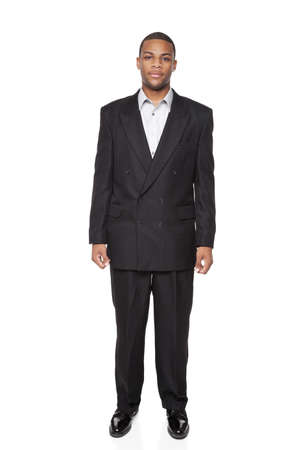 Isolated full length studio shot of the front view of an African American businessman.