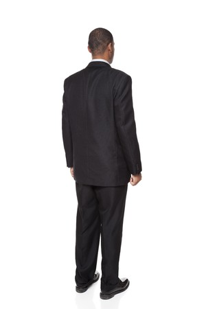 Isolated full length studio shot of the rear view of an African American businessman. Banque d'images