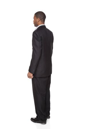 man rear view: Isolated full length studio shot of the rear view of an African American businessman. Stock Photo