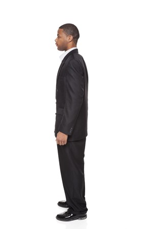 Isolated full length studio shot of side view of a tall African American businessman photo