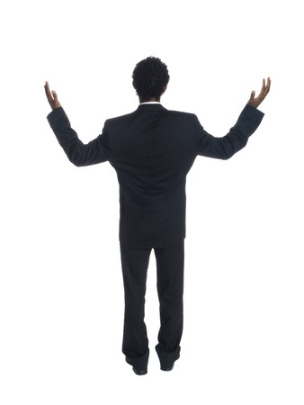 disbelief: Isolated studio shot of a businessman raising his arms in disbelief at what he sees before him. Stock Photo