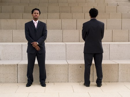 dualism: Front and back of a buisnessman on steps in front of a modern building. Stock Photo